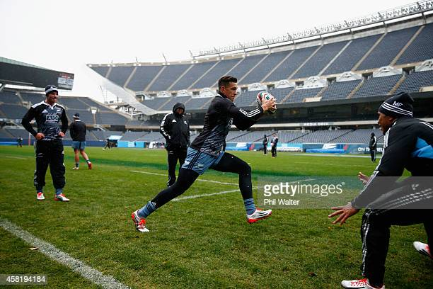 Sonny Bill Williams of the New Zealand All Blacks runs the ball during the New Zealand All Blacks Captain's run at Soldier Field on October 31, 2014...