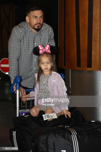 Sonny Bill Williams of the New Zealand All Blacks walks with his daughter Imman as the team returns home from the 2019 Rugby World Cup in Japan on...
