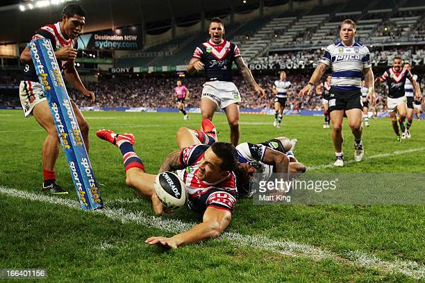 Sonny Bill Williams of the Roosters beats Ben Barba of the Bulldogs to score his first try in the corner during the round six NRL match between the...