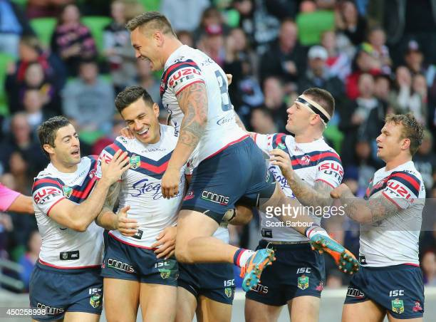 Sonny Bill Williams of the Roosters is congratulated by his teammates after scoring a try during the round 13 NRL match between the Melbourne Storm...