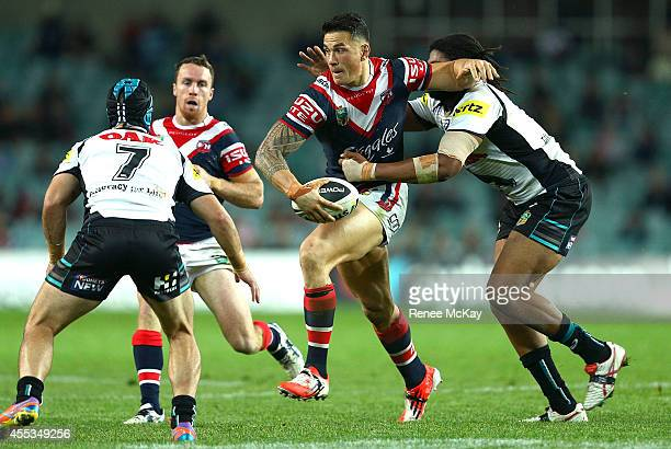 Sonny Bill Williams of the Roosters is tackled by Jamal Idris of the Panthers during the NRL 1st Qualifying Final match between the Sydney Roosters...