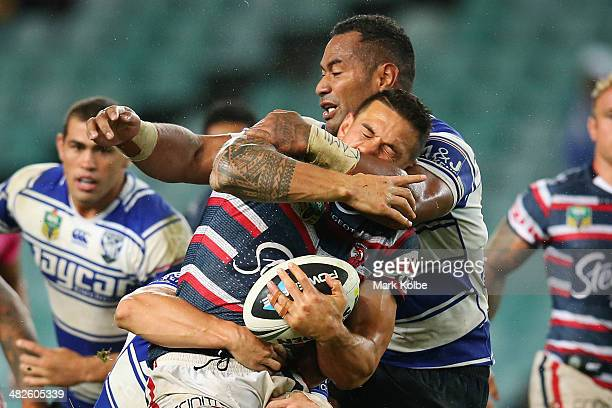 Sonny Bill Williams of the Roosters is tackled by Tony Williams of the Bulldogs during the round five NRL match between the Sydney Roosters and...