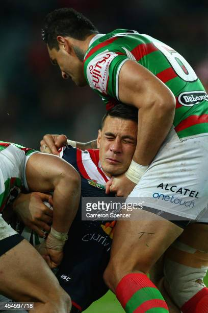 Sonny Bill Williams of the Roosters is tackled during the round 26 NRL match between the Sydney Roosters and the South Sydney Rabbitohs at Allianz...