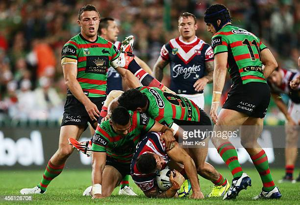 Sonny Bill Williams of the Roosters is tackled heavily by Ben Te'o of the Rabbitohs and placed on report during the First Preliminary Final match...