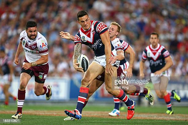 Sonny Bill Williams of the Roosters makes a break during the 2013 NRL Grand Final match between the Sydney Roosters and the Manly Warringah Sea...