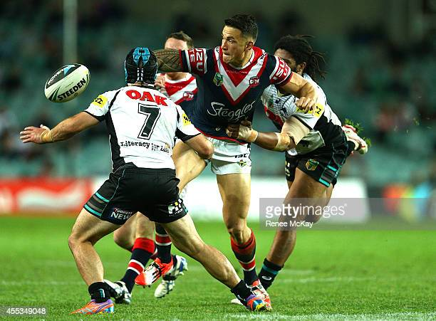 Sonny Bill Williams of the Roosters offloads the ball during the NRL 1st Qualifying Final match between the Sydney Roosters and the Penrith Panthers...