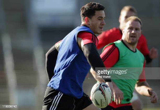 Sonny Bill Williams offloads during a New Zealand All Blacks training session at Carisbrook on July 19 2011 in Dunedin New Zealand