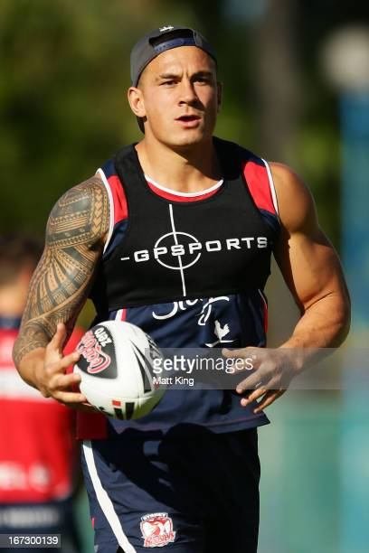 Sonny Bill Williams runs with the ball during a Sydney Roosters NRL training session at Coogee Oval on April 24 2013 in Sydney Australia