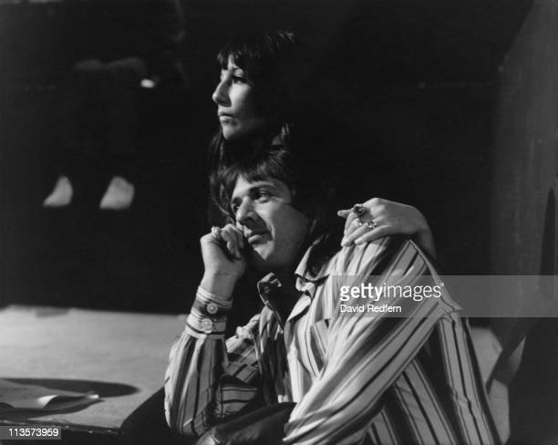 Sonny Bono US singer and his wife US singer and actress Cher circa 1965 Cher is sitting with her arm around the shoulder of Sonny who sit resting his...
