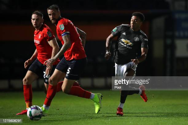Sonny Bradley of Luton Town is closed down by Jesse Lingard of Manchester United during the Carabao Cup Third Round match between Luton Town and...