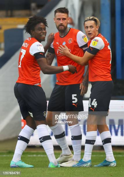 Sonny Bradley of Luton Town is congratulated after the Blackburn Rovers score a second own goal during the Sky Bet Championship match between Luton...