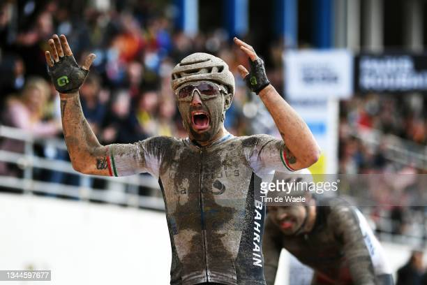 Sonny Colbrelli of Italy and Team Bahrain Victorious covered in mud celebrates winning in the Roubaix Velodrome - Vélodrome André Pétrieux during the...