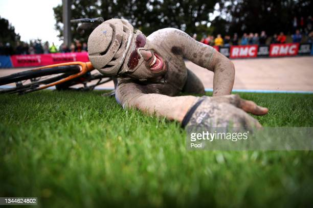 Sonny Colbrelli of Italy and Team Bahrain Victorious covered in mud celebrates winning in the Roubaix Velodrome - Vélodrome André Pétrieux after the...