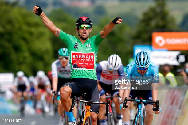 Sonny Colbrelli of Italy and Team Bahrain Victorious Green Points Jersey stage winner celebrates at arrival, Alex Aranburu Deba of Spain and Team...