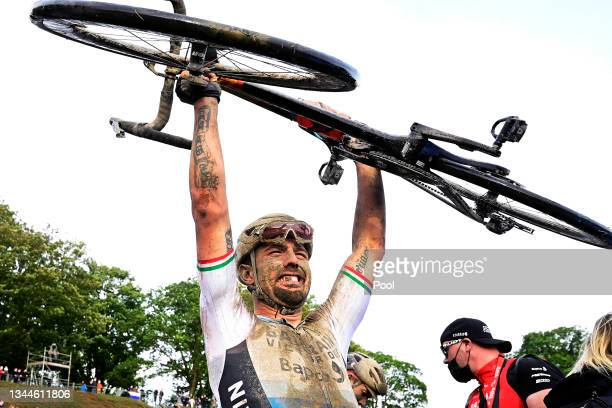 Sonny Colbrelli of Italy and Team Bahrain Victorious lifts his bicycle to celebrates winning in the Roubaix Velodrome - Vélodrome André Pétrieux...