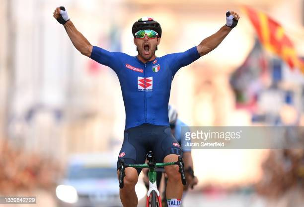 Sonny Colbrelli of Italy celebrates winning ahead of Remco Evenepoel of Belgium during the 27th UEC Road Cycling European Championships 2021, Elite...