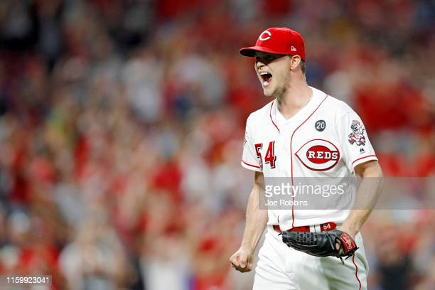 Sonny Gray of the Cincinnati Reds reacts after getting the final out in the eighth inning against the Milwaukee Brewers at Great American Ball Park...