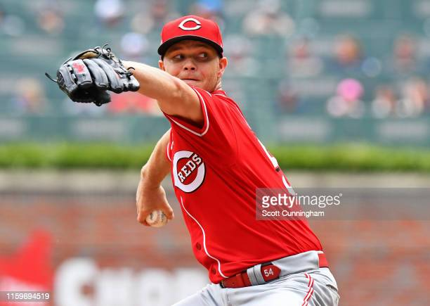 Sonny Gray of the Cincinnati Reds throws a third inning pitch against the Atlanta Braves at SunTrust Park on August 4, 2019 in Atlanta, Georgia.