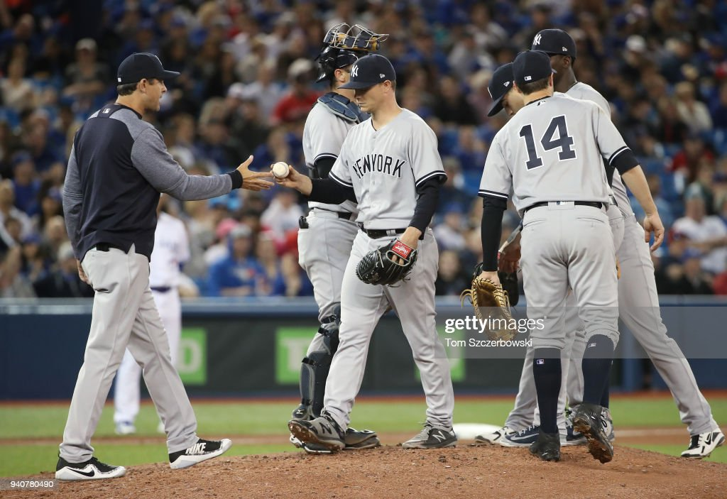 Sonny Gray #55 of the New York Yankees is relieved by manager Aaron Boone #17 as he exits the game in the fifth inning during MLB game action against the Toronto Blue Jays at Rogers Centre on April 1, 2018 in Toronto, Canada.