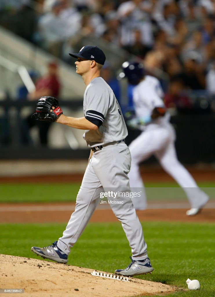 Sonny Gray #55 of the New York Yankees stands on the mound after surrendering an eighth inning home run against Adeiny Hechavarria #11 of the Tampa Bay Rays at Citi Field on September 12, 2017 in the Flushing neighborhood of the Queens borough of New York City. The two teams were scheduled to play in St. Petersburg, Florida but due to the weather emergency caused by Hurricane Irma, the game was moved to New York, but with Tampa Bay remaining the 'home' team.
