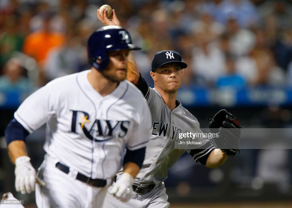 Sonny Gray #55 of the New York Yankees throws out Lucas Duda #21 of the Tampa Bay Rays during the sixth inning at Citi Field on September 12, 2017 in the Flushing neighborhood of the Queens borough of New York City. The two teams were scheduled to play in St. Petersburg, Florida but due to the weather emergency caused by Hurricane Irma, the game was moved to New York, but with Tampa Bay remaining the 'home' team.