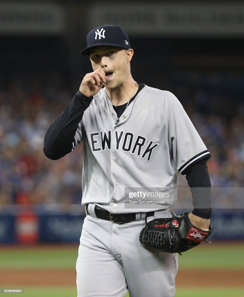 Sonny Gray #55 of the New York Yankees walks off the mound and heads to the dugout after getting the last out of the sixth inning during MLB game action against the Toronto Blue Jays at Rogers Centre on August 10, 2017 in Toronto, Canada.