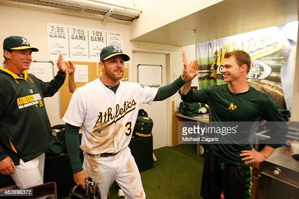 Sonny Gray of the Oakland Athletics celebrates with Craig Gentry and Manager Bob Melvin in the clubhouse following the game against the San Francisco...
