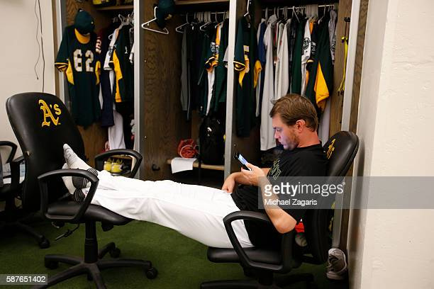 Sonny Gray of the Oakland Athletics checks his phone in the clubhouse prior to the game against the Houston Astros at the Oakland Coliseum on July 20...