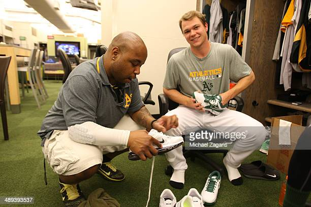 Sonny Gray of the Oakland Athletics gets his shoes worked on by clubbie 'Big Sean' in the clubhouse prior to the game against the Houston Astros at...