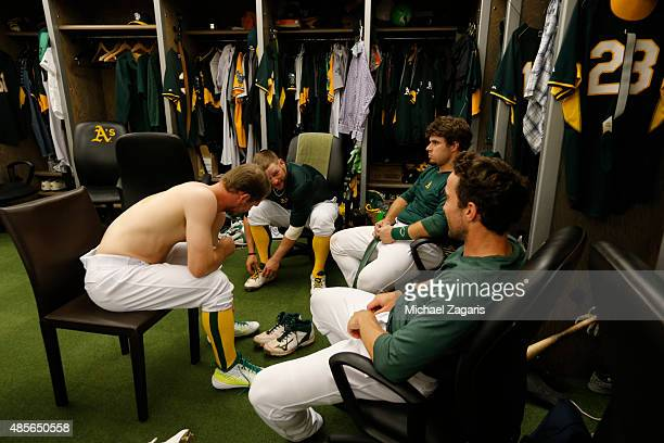 Sonny Gray Stephen Vogt Josh Phegley and Sam Fuld of the Oakland Athletics relax in the clubhouse prior to the game against the Los Angeles Dodgers...