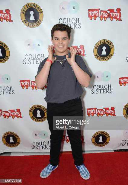 Sonny Gregoria attends The Couch Sisters 1st Annual Toys For Tots Toy Drive held onNovember 20 2019 in Glendale California