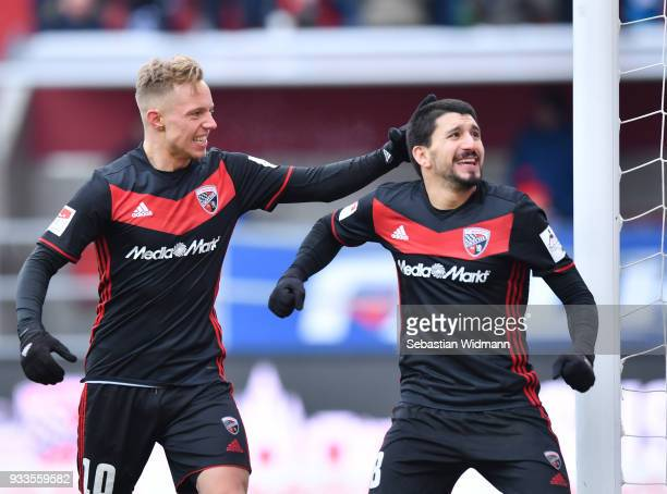 Sonny Kittel and Almog Cohen of Ingolstadt celebrate their teams fourth goal during the Second Bundesliga match between FC Ingolstadt 04 and SG...