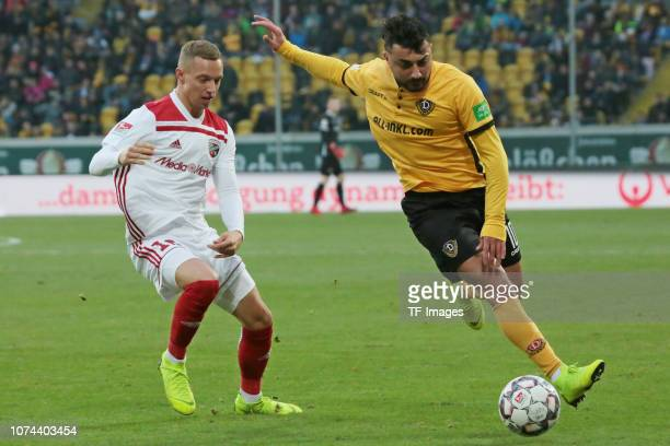 Sonny Kittel of FC Ingolstadt 04 Aias Aosman of Dynamo Dresden battle for the ball during the Bundesliga match between Dynamo Dresden and FC...