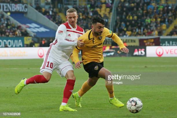 Sonny Kittel of FC Ingolstadt 04 and Aias Aosman of Dynamo Dresden battle for the ball during the Bundesliga match between Dynamo Dresden and FC...