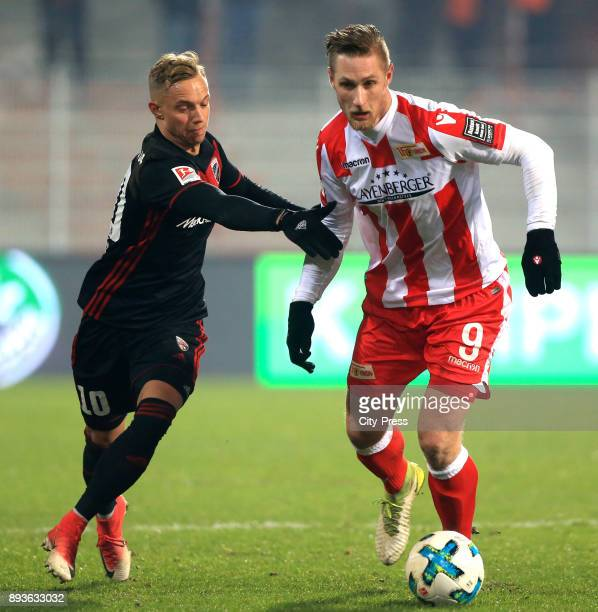 Sonny Kittel of FC Ingolstadt 04 and Sebastian Polter of 1FC Union Berlin during the game between Union Berlin and dem FC Ingolstadt 04 on december...