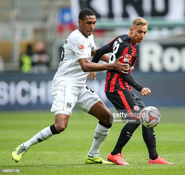 Sonny Kittel of Frankfurt is challenged by Marcelo of Hannover during the Bundesliga match between Eintracht Frankfurt and Hannover 96 at...
