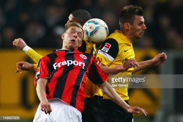Sonny Kittel of Frankfurt jumps for a header with Anouar Hadouir and Timo Achenbach of Aachen during the Second Bundesliga match between Alemannia...
