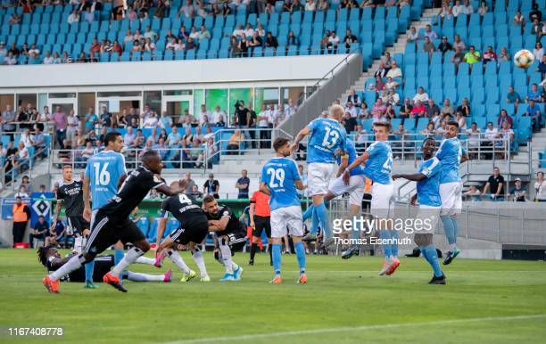 Sonny Kittel of Hamburg scores his team's second goal with a free kick during the DFB Cup first round match between Chemnitzer FC and Hamburger SV at...