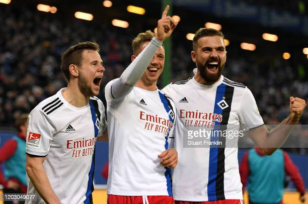 Sonny Kittel of Hamburger SV celebrates after scoring his sides third goal with Louis Schaub and Lukas Hinterseer during the Second Bundesliga match...
