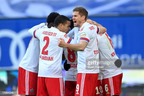 Sonny Kittel of Hamburger SV celebrates with teammates Jan Gyamerah, Jeremy Dudziak, Simon Terodde, and David Kinsombi after scoring his team's third...