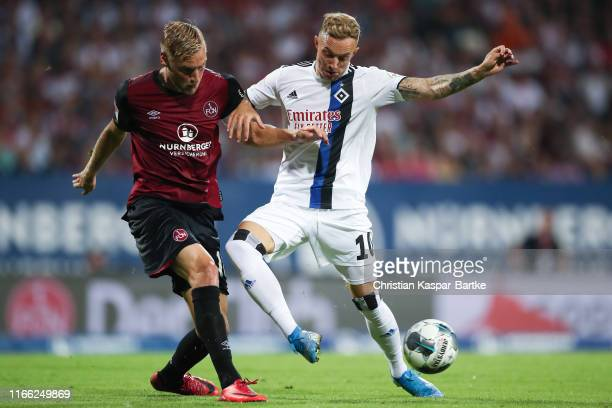Sonny Kittel of Hannover is challenged by Hanno Behrens of Nuernberg during the Second Bundesliga match between 1. FC Nuernberg and Hamburger SV at...