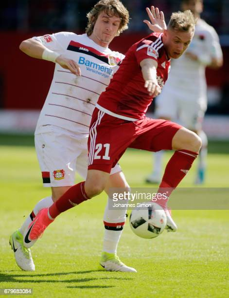 Sonny Kittel of Ingolstadt and Tin Jedvaj of Leverkusen fight for the ball during the Bundesliga match between FC Ingolstadt 04 and Bayer 04...