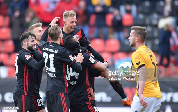 Sonny Kittel of Ingolstadt celebrates with his teammates their fourth goal during the Second Bundesliga match between FC Ingolstadt 04 and SG Dynamo...
