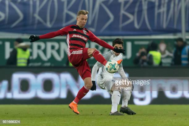 Sonny Kittel of Ingolstadt und Danilo Teodoro Soares of Bochum battle for the ball during the Second Bundesliga match between FC Ingolstadt 04 and...