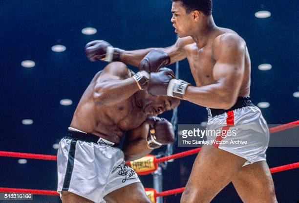Sonny Liston dodges a right hook by Cassius Clay during their bout at the Convention Center in Miami Beach Florida February 25 1964 Cassius Clay won...