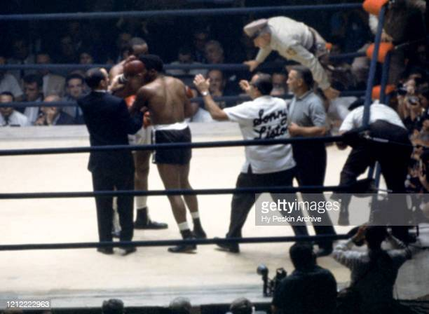 Sonny Liston hugs Floyd Patterson after Liston's knockout in the first round of their second fight on July 22, 1963 at the Las Vegas Convention...