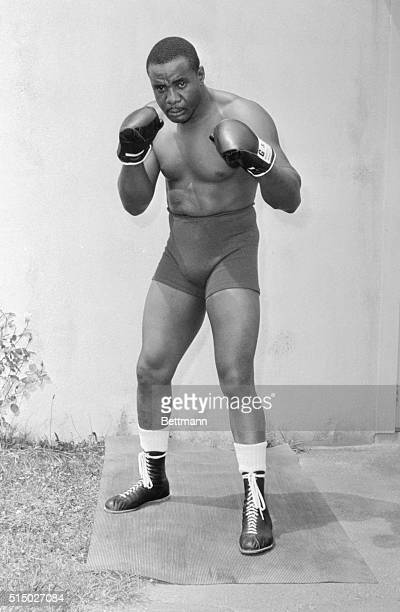 Sonny Liston is shown in these posed action photos at his Pines Hotel training camp in preparation for his upcoming bout with heavyweight champ,...