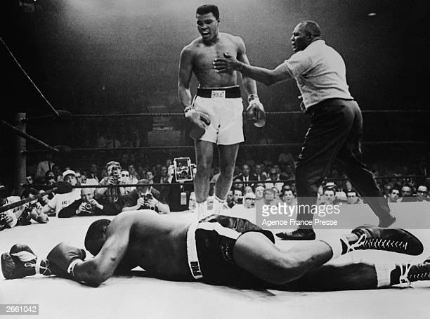 Sonny Liston lies out for the count after being KO'd in the first round of his return title fight by world heavyweight champion Muhammad Ali,...