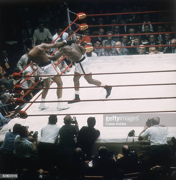Sonny Liston right and Cassius Clay in action during their heavyweight title fight at Miami Beach Florida Clay won the contest becoming world...