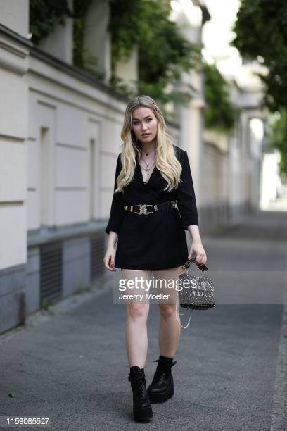 Sonny Loops wearing a Maison Valentino bag Asos shoes a jumpsuit from Only and Asos hairclip on June 29 2019 in Berlin Germany